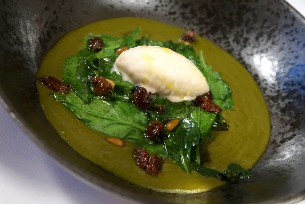spinach, pine nuts and raisins at Tast