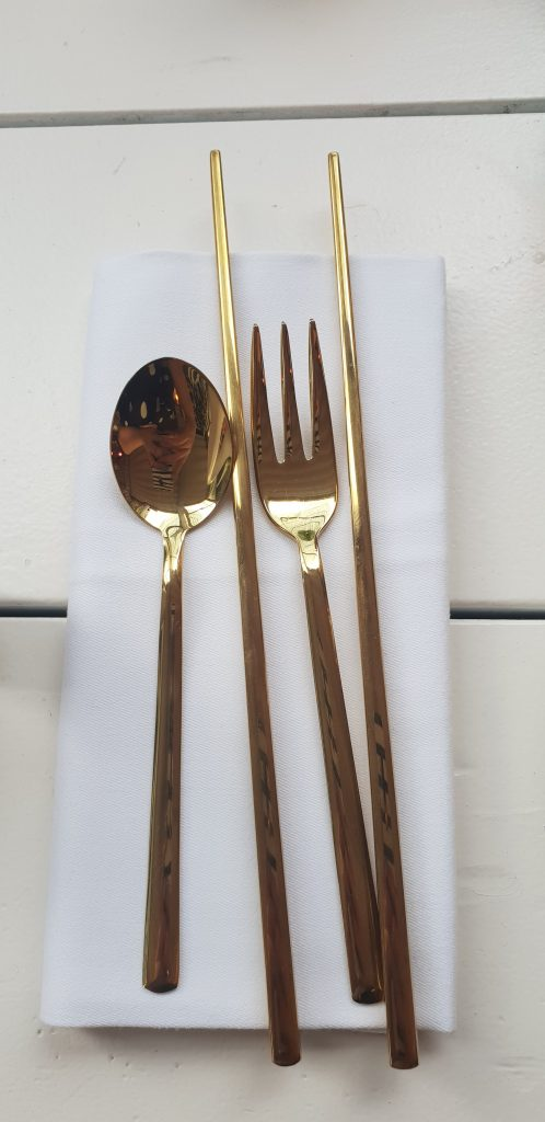gold cutlery setting at sunset manchester