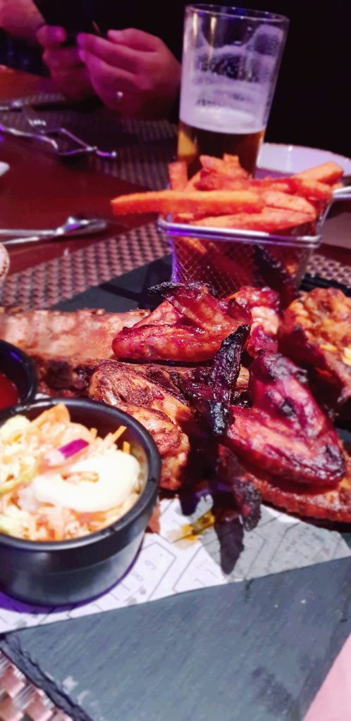 ribs and wings with fries and slaw at worsley park